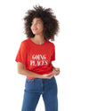 "women in jeans wearing a red t-shirt with ""going places"" in uppercase white text"