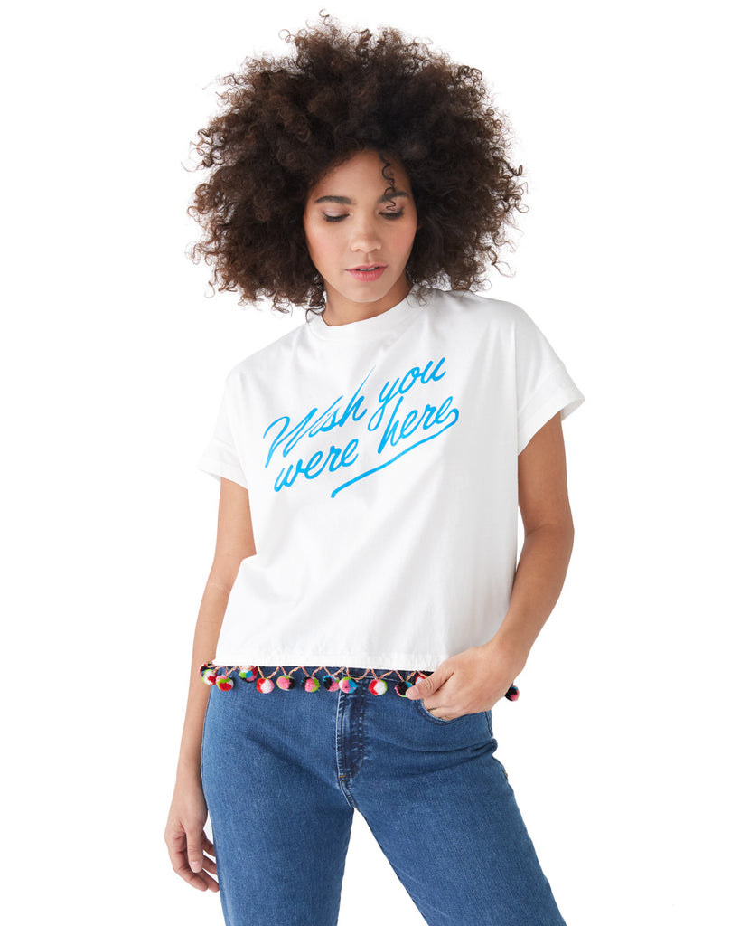 This tee comes in white, with 'Wish You Were Here' printed in light blue on the front.