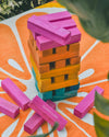 giant wooden jumbling tower on orange towel