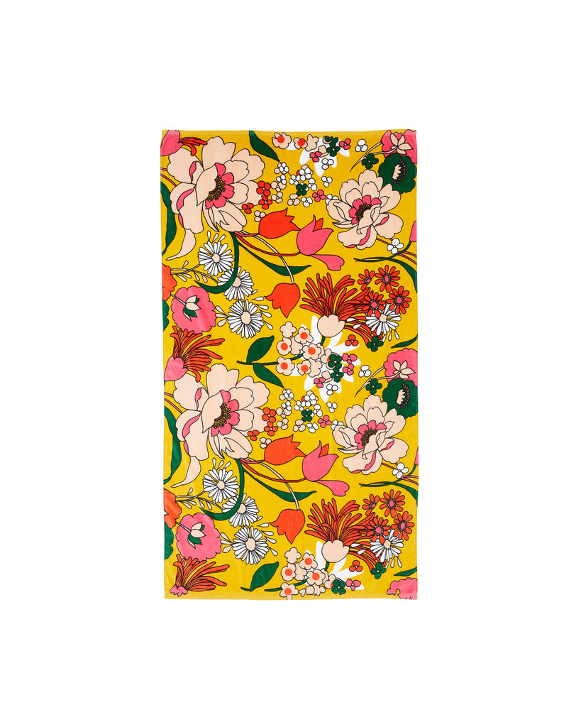 Yellow towel with bright floral pattern design all over.