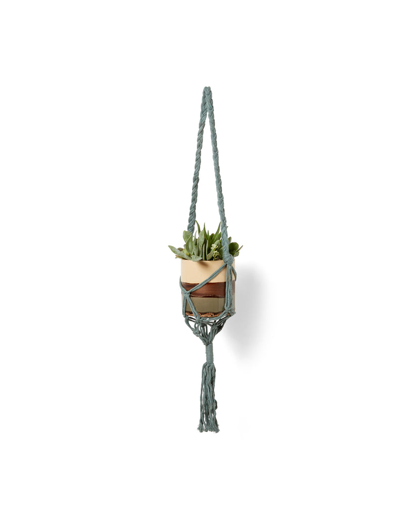 green yarn tote shown as plant hanger