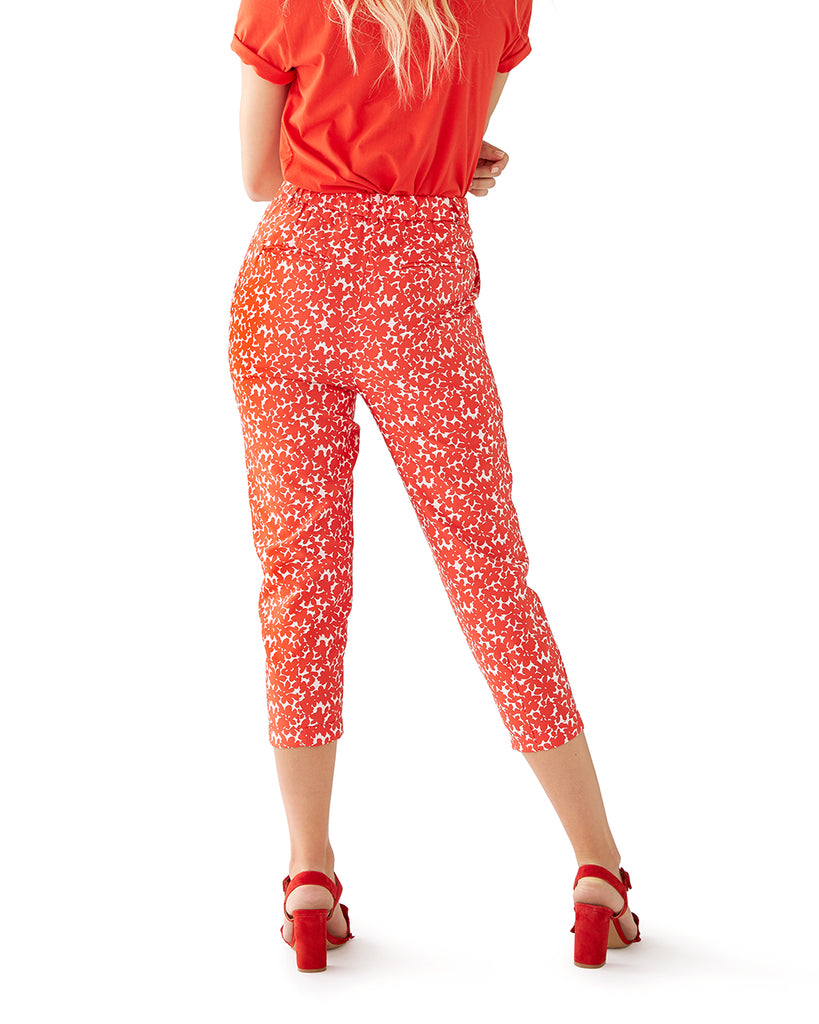 Back of red and white floral printed pants with cropped length