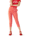 Red and white floral printed pants with cropped length and button closure