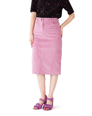 lavender corduroy pencil skirt shown on model wearing a black confetti tee with purple ruffle heels