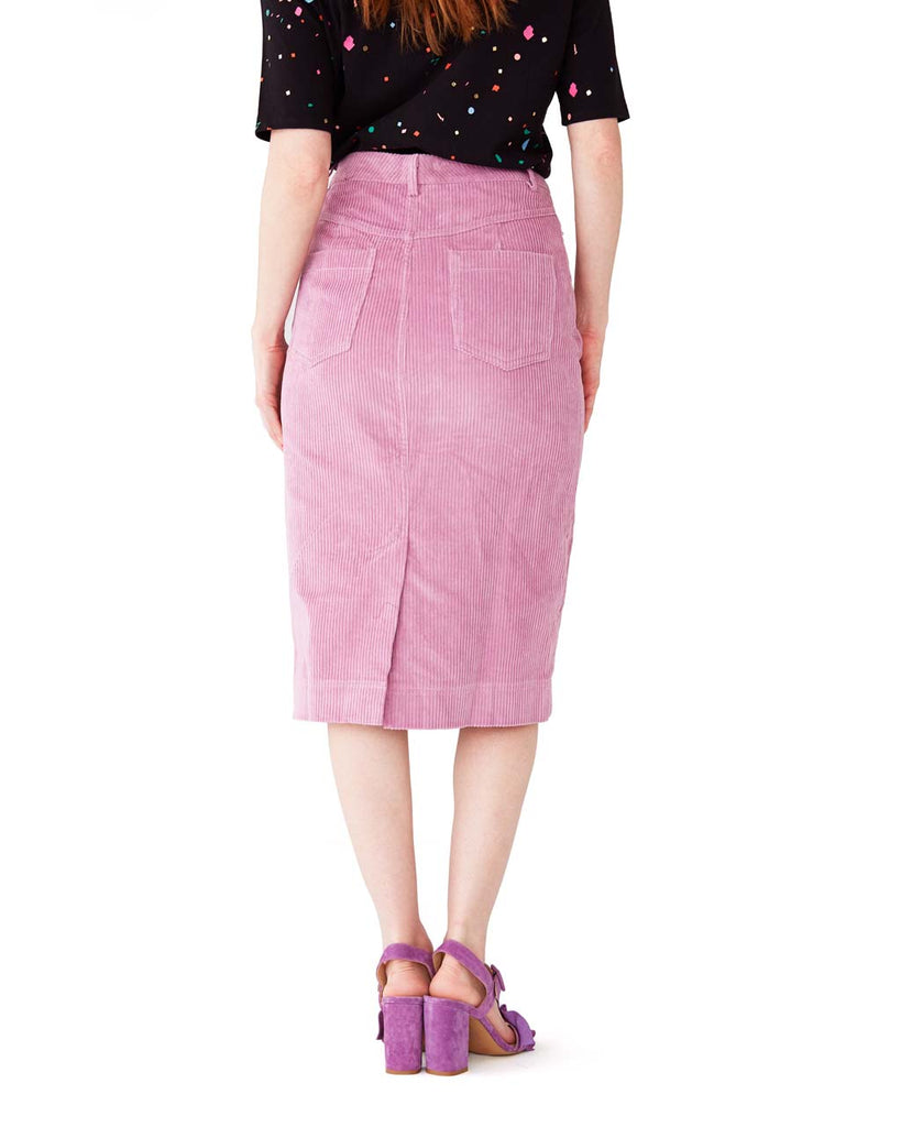 back view of lavender corduroy skirt with pockets and a lower slit