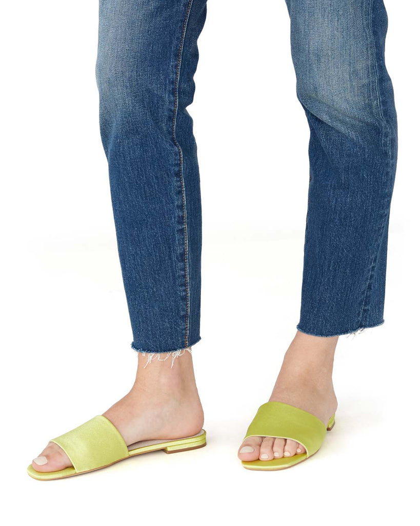neon yellow wide strap sandals shown on model from the side