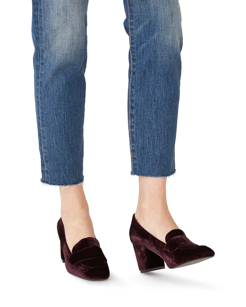 woman stepping in high heel velvet loafers