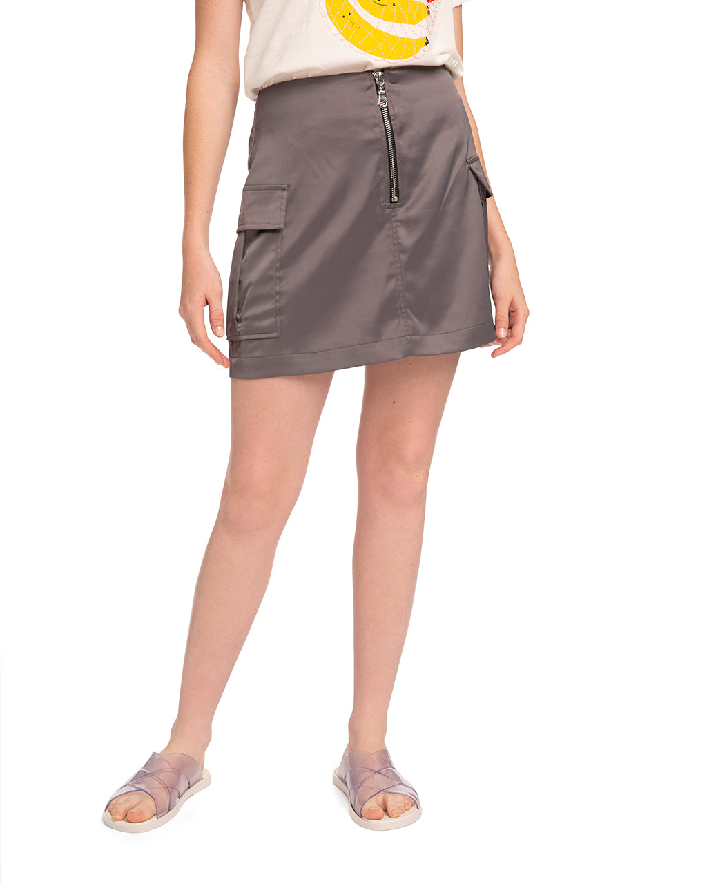 woman wearing a satin skirt with cargo pockets and an exposed front zipper