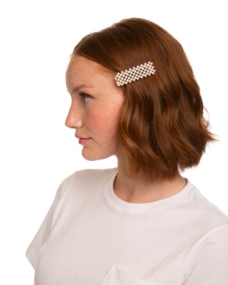 Rectangle hair clip covered in pearls.