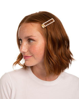 Rectangular pearl outlined hair clip.