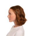 red headed model shown wearing unique shaped gold barrette
