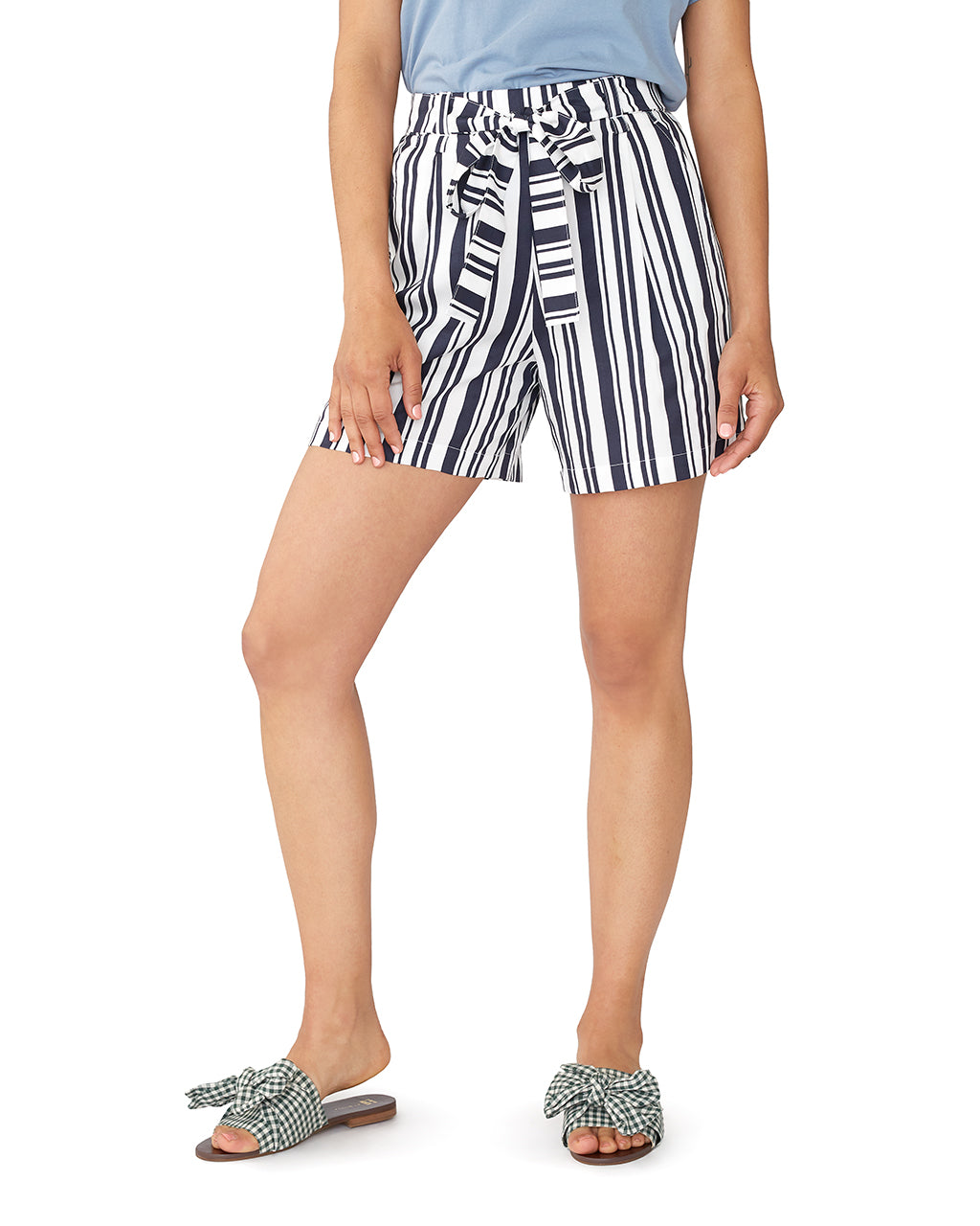 woman wearing sandals and striped shorts