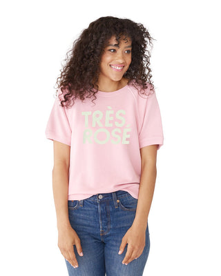 This short-sleeve sweatshirt comes in pink, with 'Très Rosé' printed in white on the front.