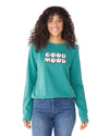 This sweatshirt comes in jewel green, with 'Good Mood' printed in pink on the front.