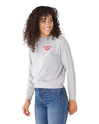This sweatshirt comes in light grey with 'Can't Complain' embroidered on the front.