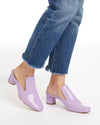 Lilac leather mules.