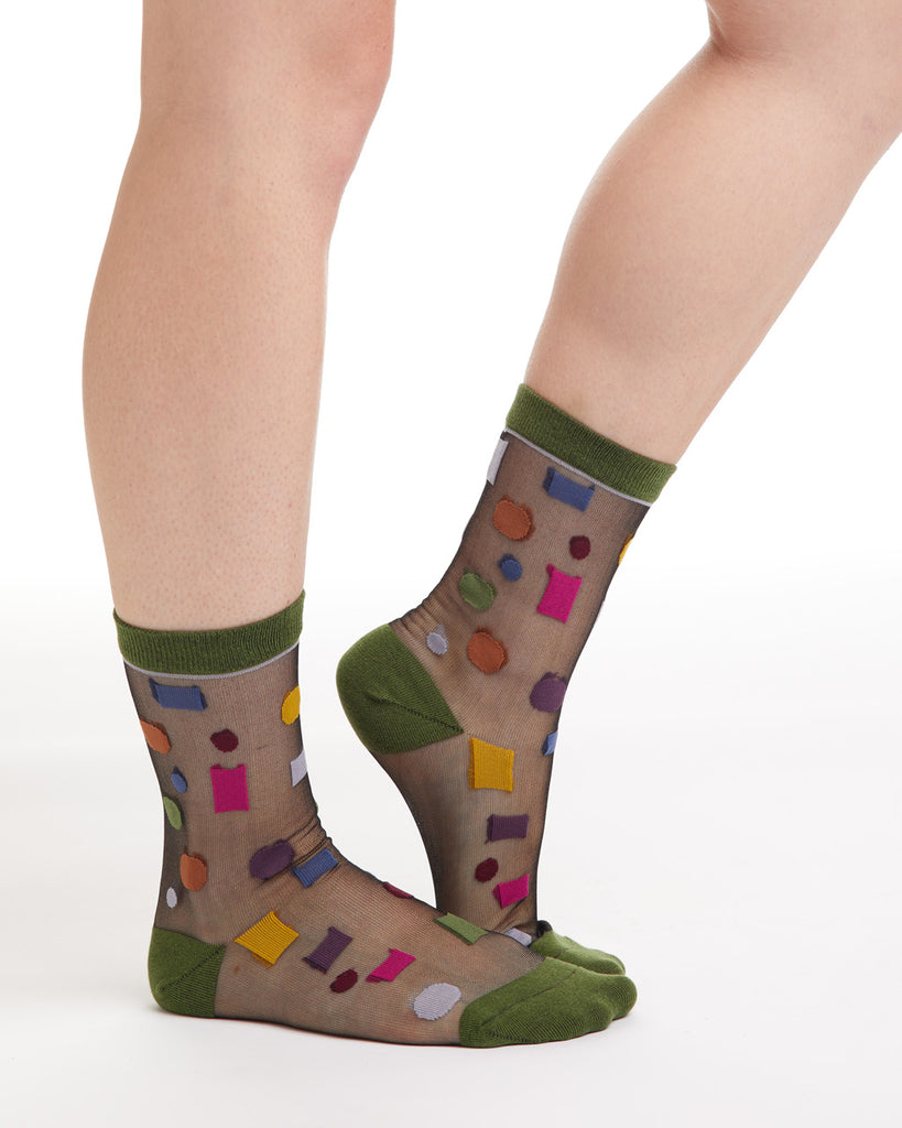 Sheer nylon socks with confetti pattern and forest green ankle and toe.