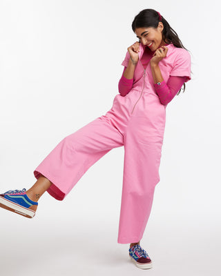 Pink short sleeve coverall styled with a sheer pink turtleneck.