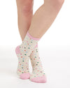 White crew socks with a pink heel and toe cap and multi color confetti dots.