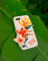 Silicone iPhone case with tropical flowers sitting on a large green leaf