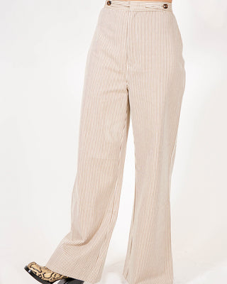 brown and white pin stripe flare pant shown on model