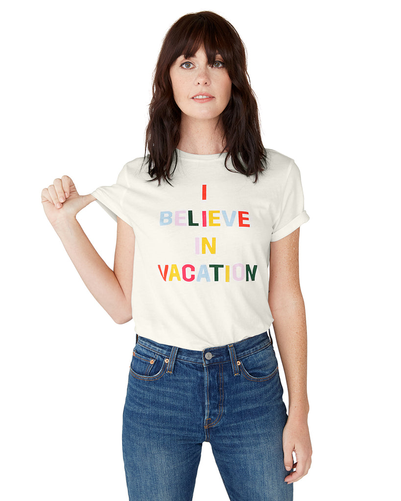 This tee comes in white, with 'I Believe In Vacation' printed in rainbow on the front.