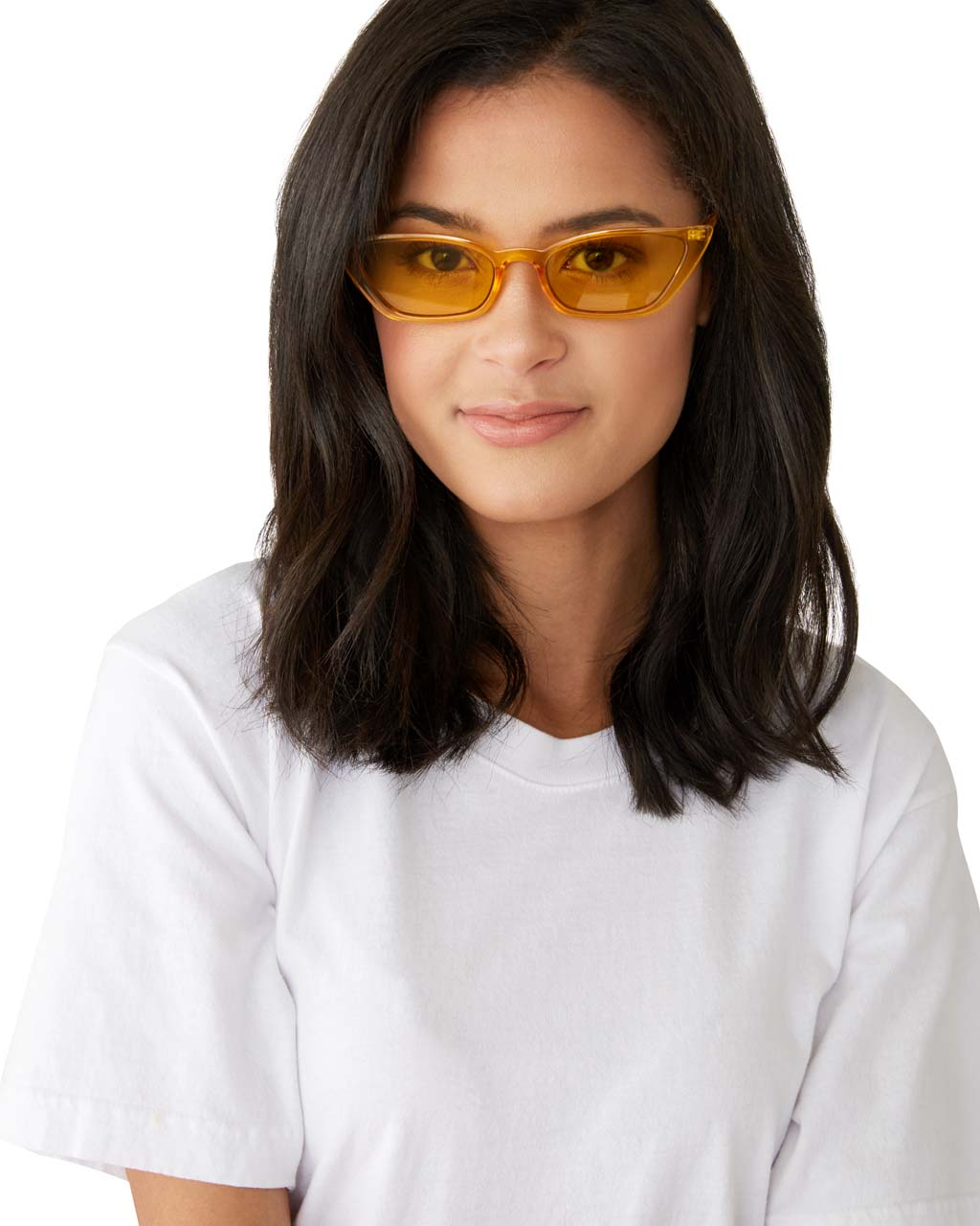 model wearing transparent yellow cat-eye sunglasses with yellow lenses