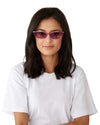 Model wearing transparent lilac cat-eye sunglasses with lilac lenses o