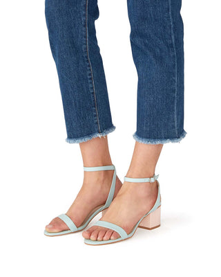 woman in cropped denim wearing light blue sandals