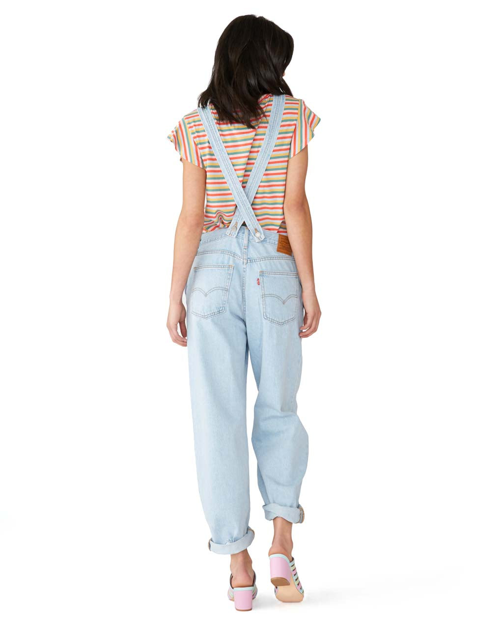 Adjustable straps crisscross in the back.