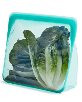 mega stasher bag shown with lettuce