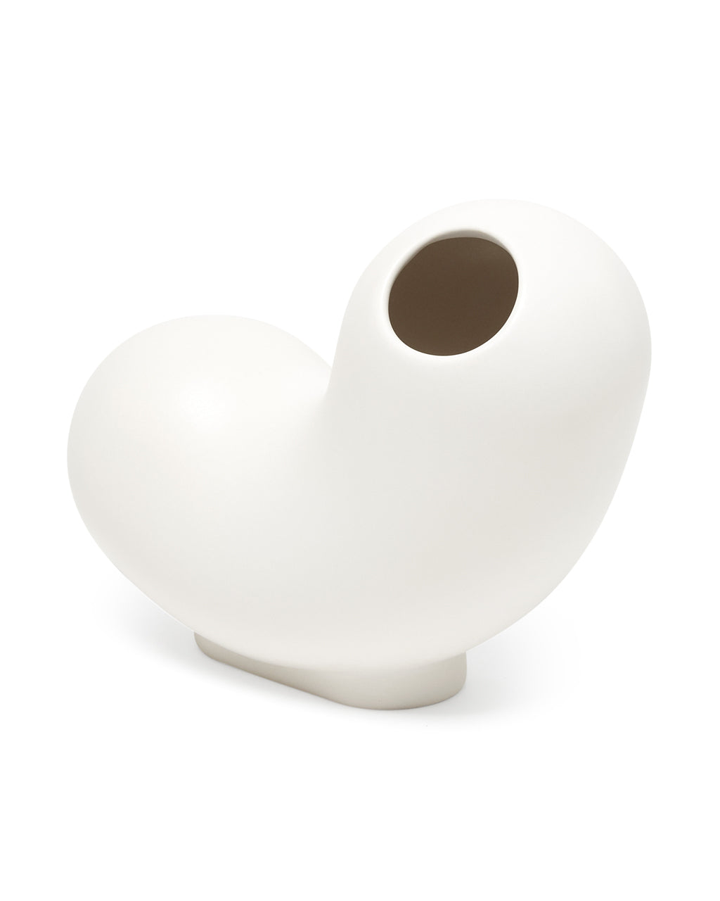 white ceramic curly vase