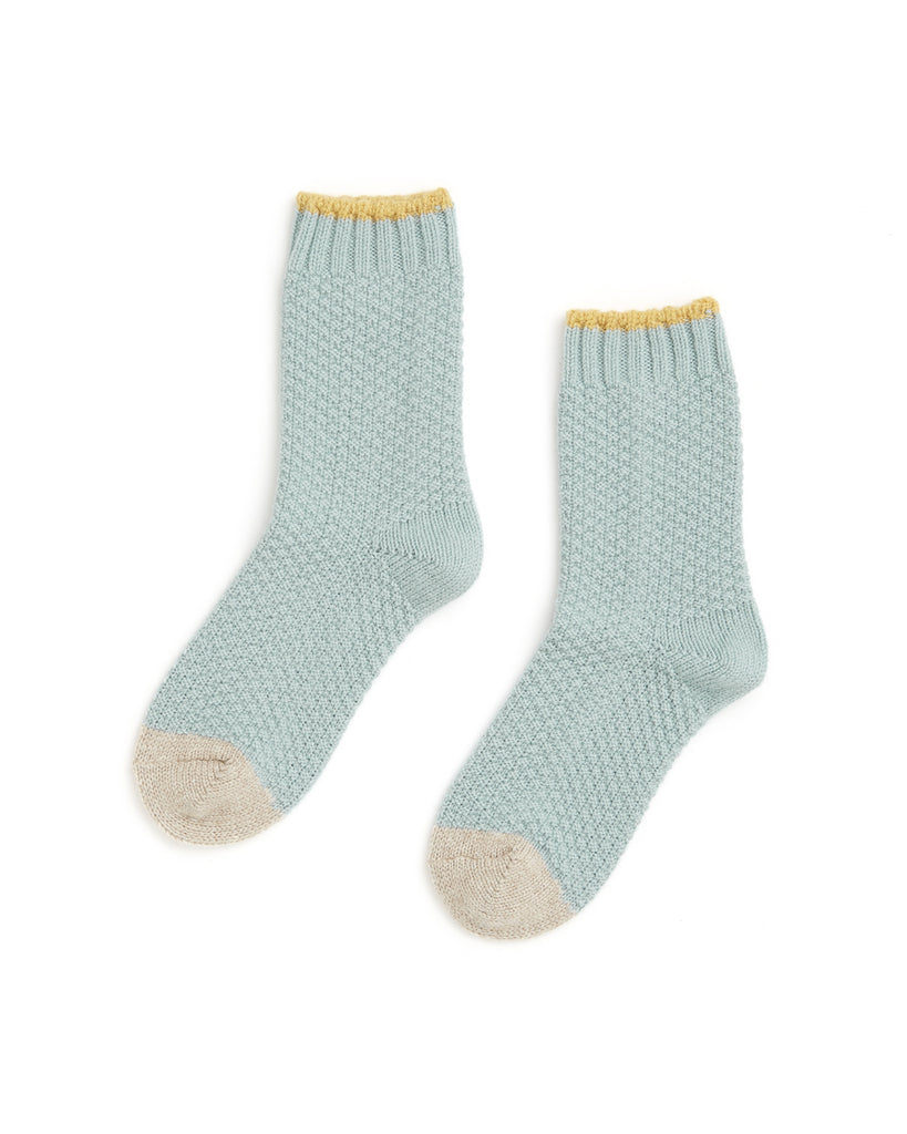 seafoam green socks with yellow rib at top and oatmeal colored toes