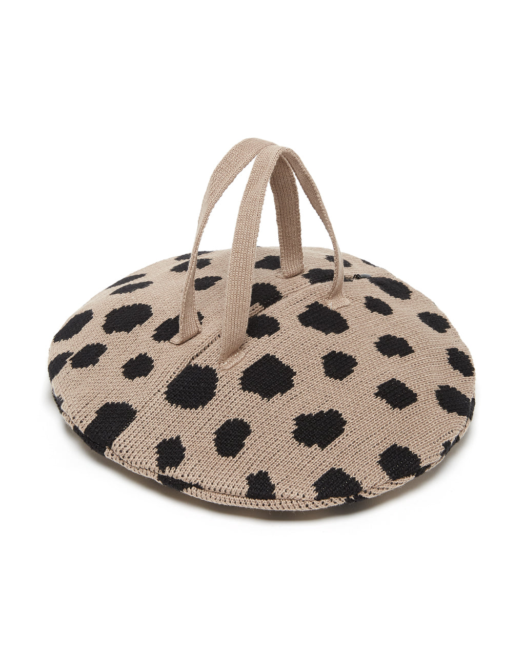 round beige bag with black dots, in knit material with hidden zipper and two straps