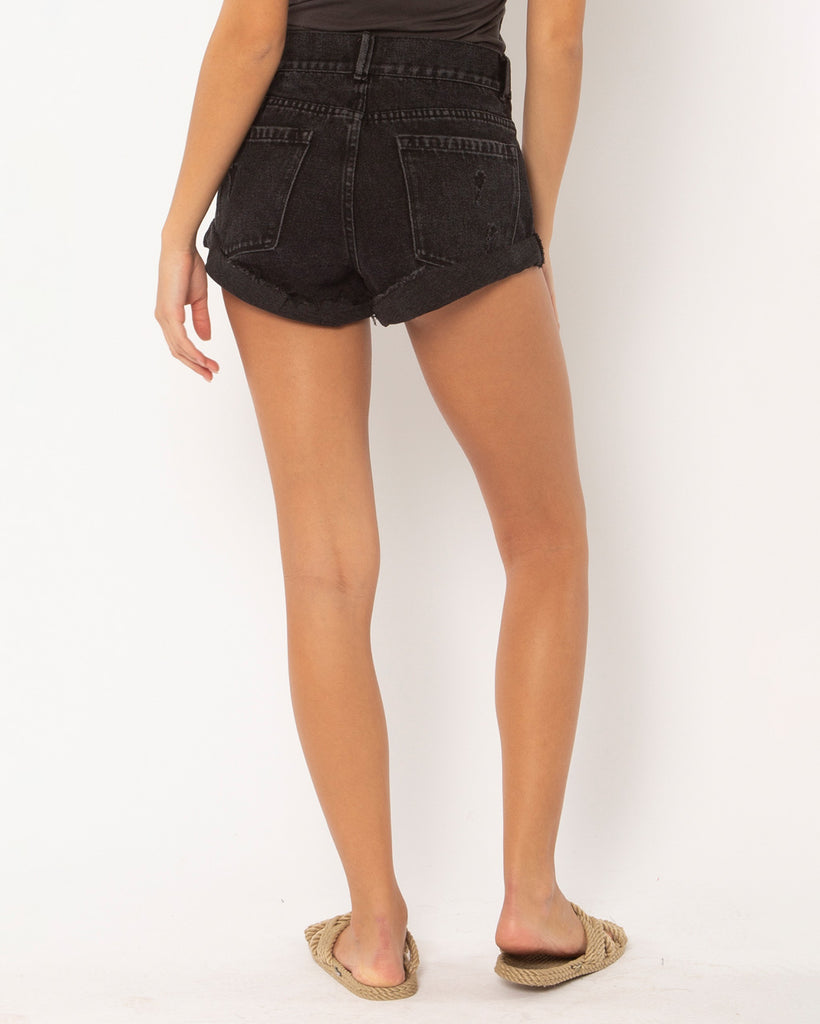 model wearing black denim cutoff shorts with brown woven rope sandals
