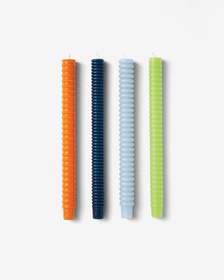 set of 4 spiral taper candles in orange, navy, pale blue, lime green shown flat