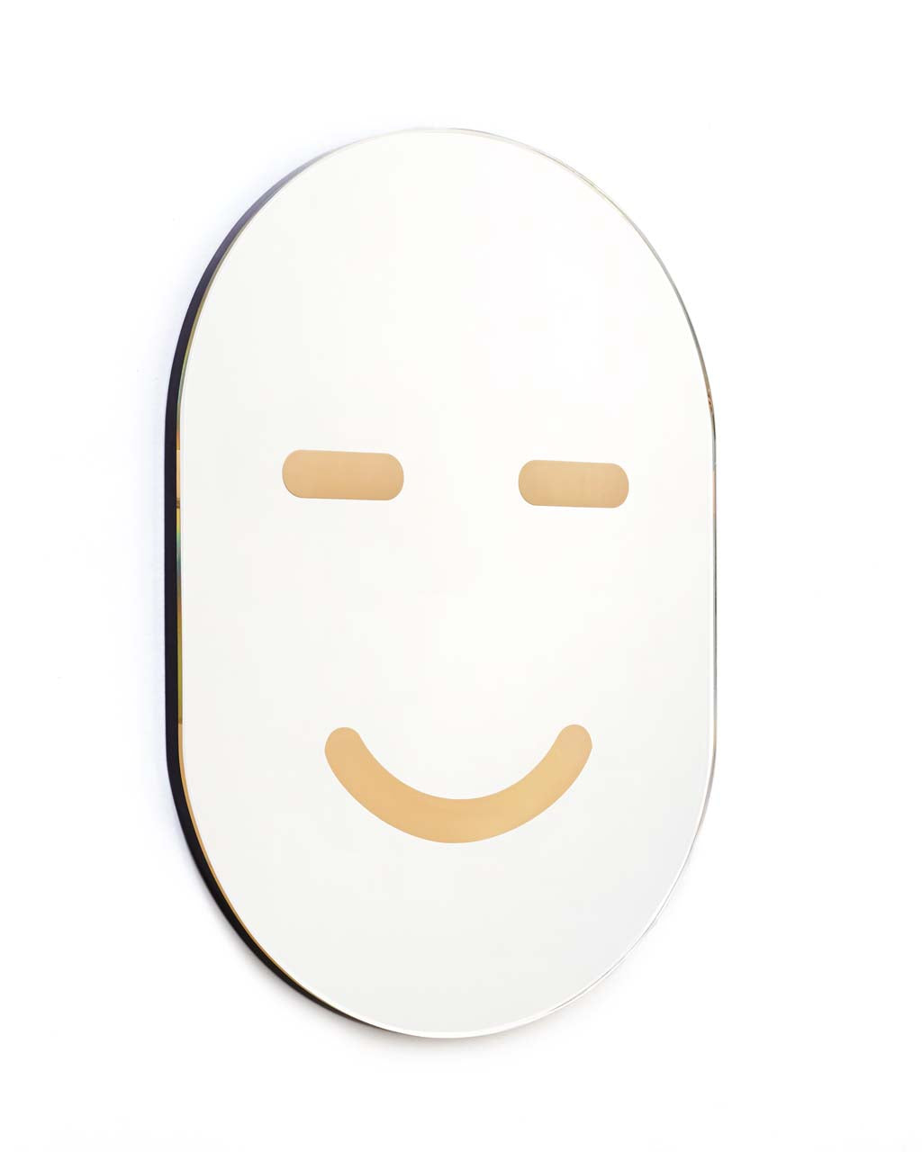 This mirror by Areaware has a yellow happy face painted on the front.