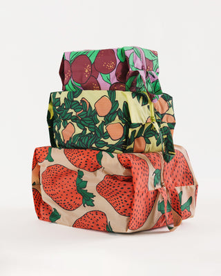 set of 3 baggu zip pouches in different fruit patterns: strawberry, orange tree, plum