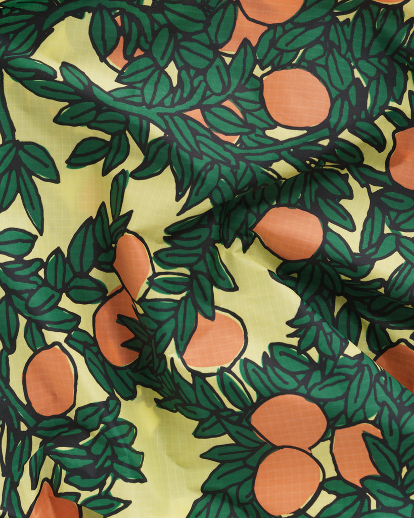 detail shot of yellow baggu with all over orange tree print