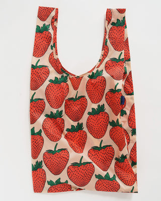 big baggu in blush pink with large red strawberry pattern