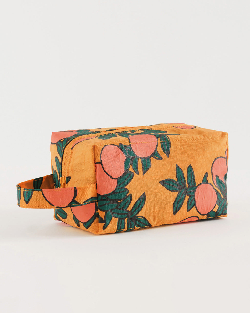 dopp kit with handle in marigold with all over orange tree pattern