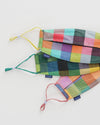 back view of set of 3 fabric masks with adjustable loops in multicolor madras plaid prints