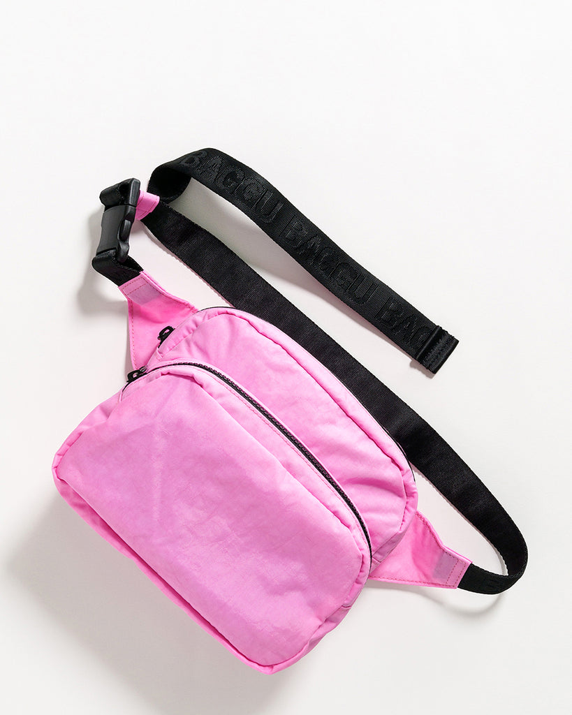 bright pink nylon fanny pack with a 48 inch strap