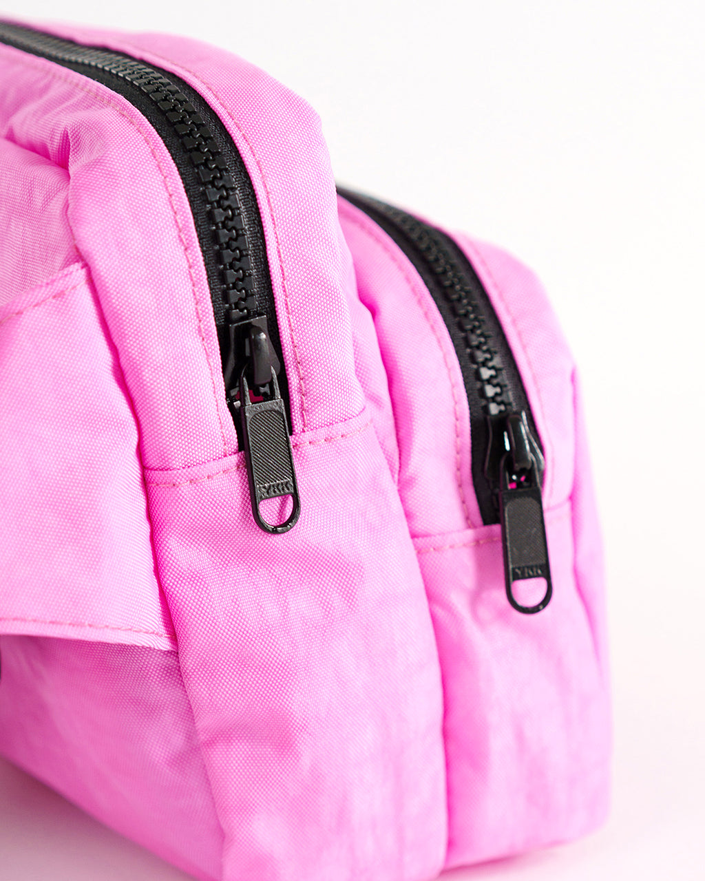 bright pink nylon fanny pack with double zip pockets
