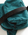 detail of nylon fanny pack in malachite blue with black strap
