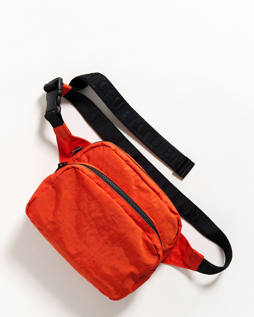 Bright red nylon fanny pack with a 48 inch strap