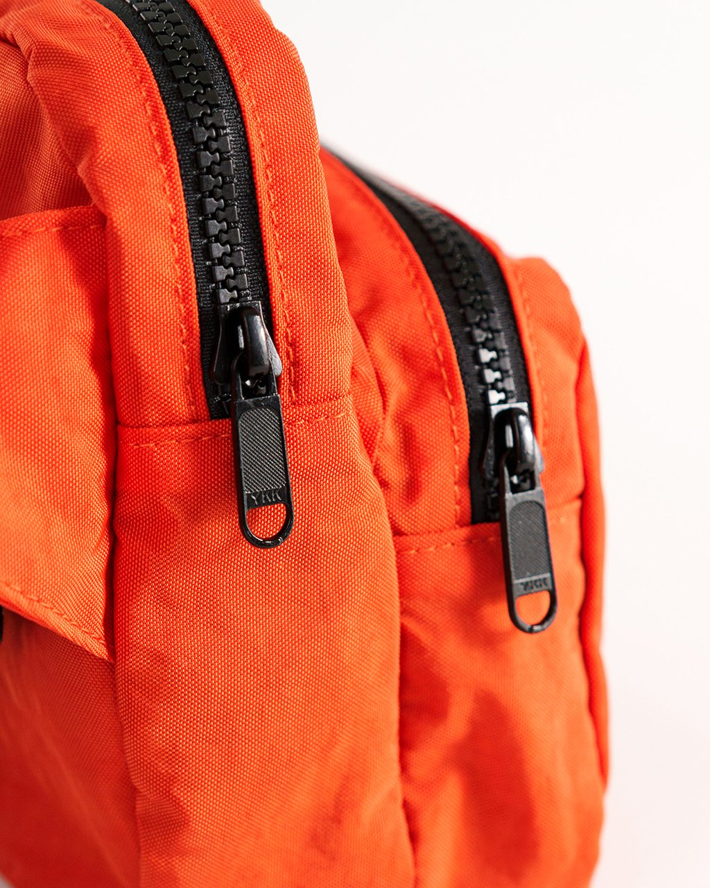 Detailed shot of the double zip pockets