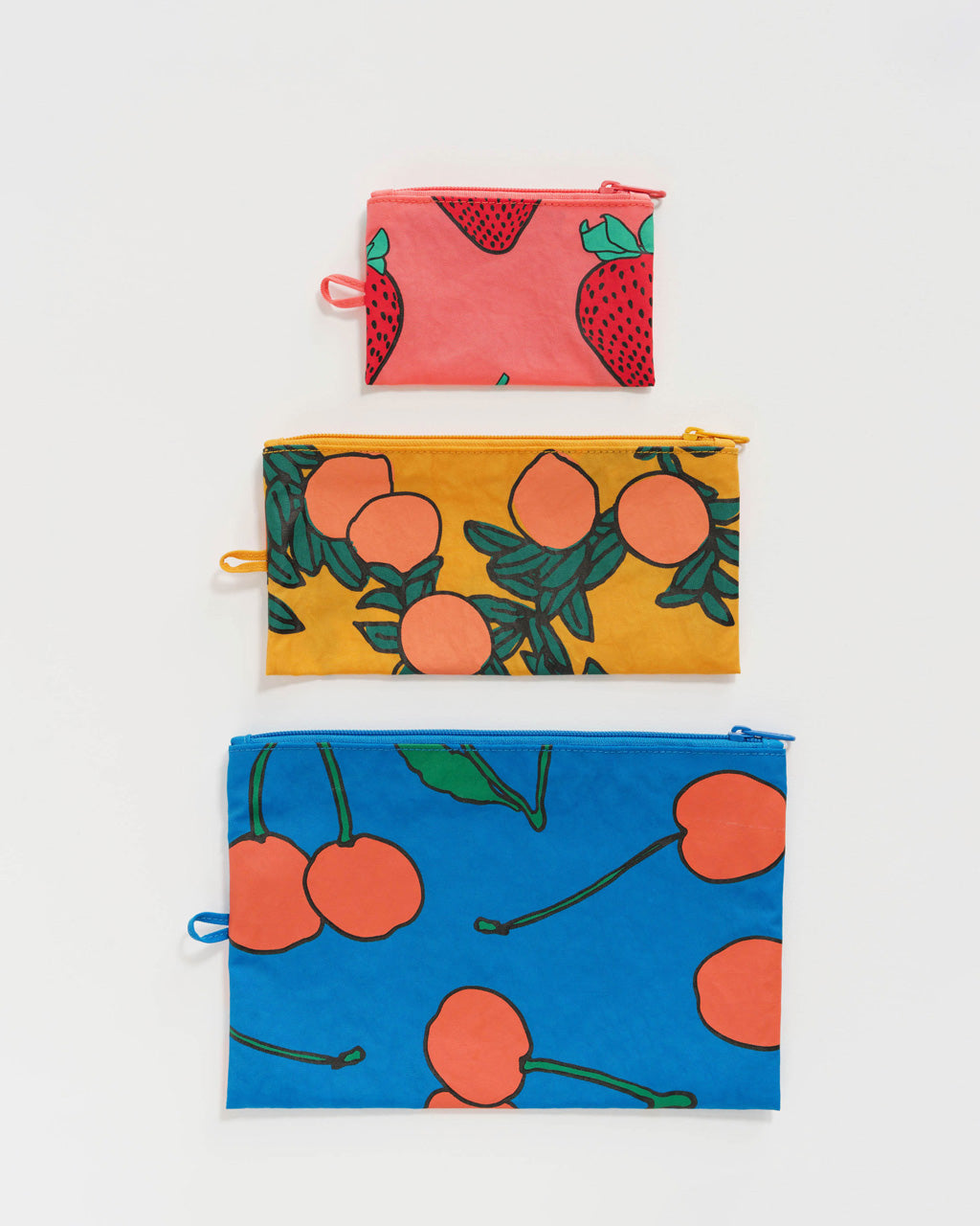 set of 3 nylon pouches in assorted sizes in 3 different patterns: blue with red cherries, marigold with orange tree print, pink with red strawberries