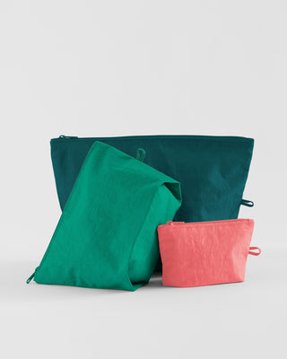 set of 3 nylon pouches in assorted sizes in 3 different colors: teal, turquoise, pink
