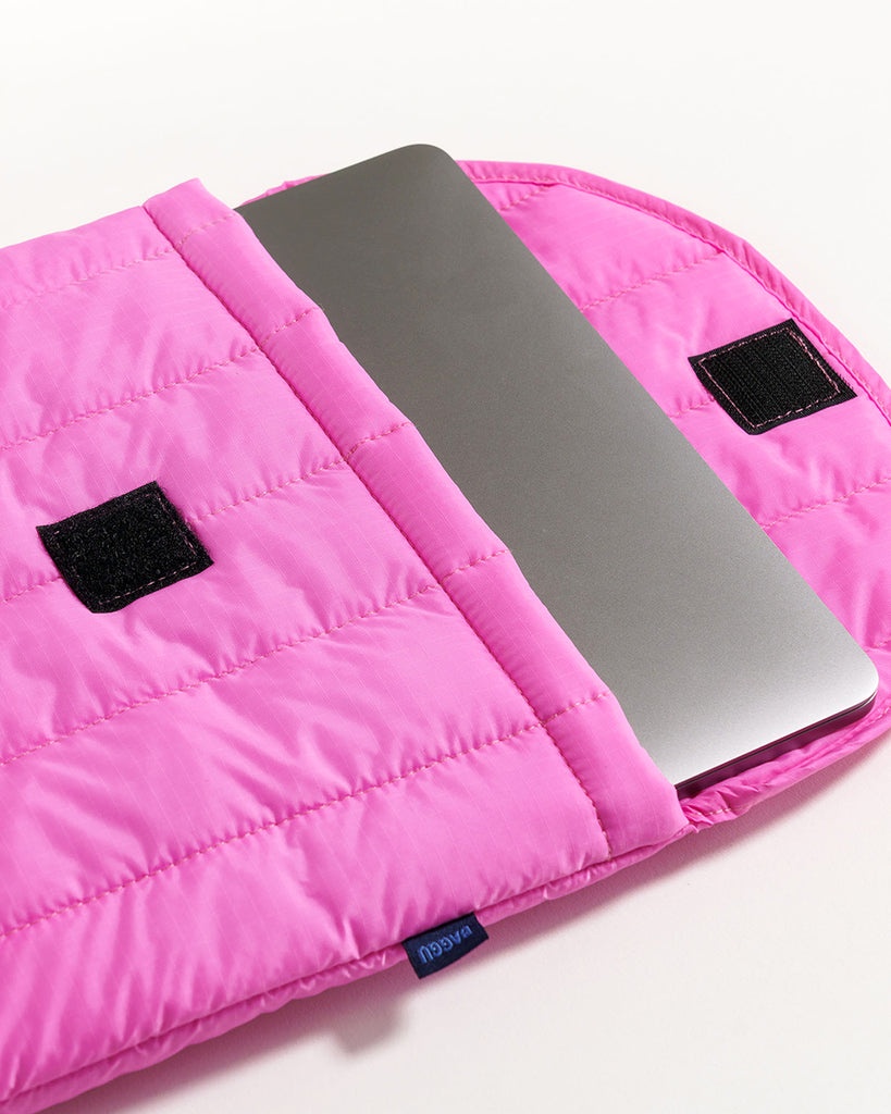 puffy hot pink laptop sleeve shown with a laptop